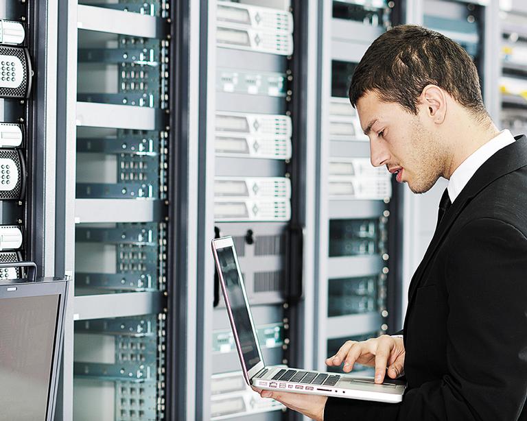 IT worker servicing server racks